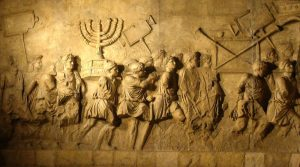 הבבלים סוחבים את המנורה והכלים של בית המקדש לגלות